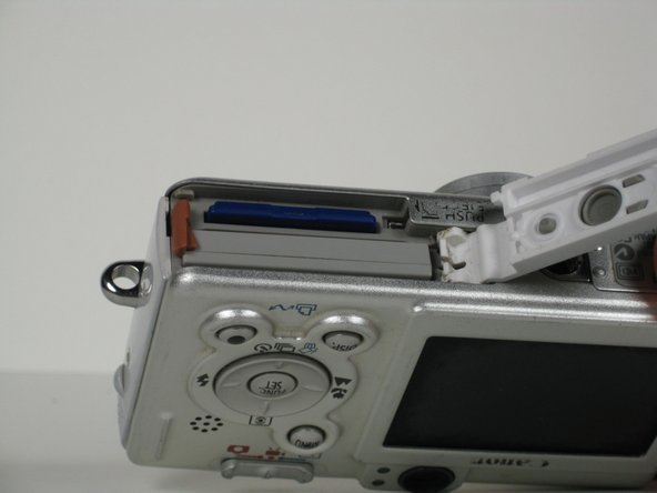 Image 3/3: The battery and the memory card slots should now be visible.