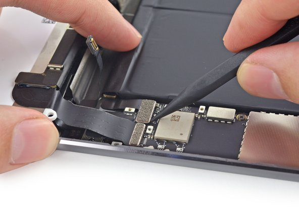 Use the tip of a spudger to gently lift the battery connector up off its socket on the logic board.
