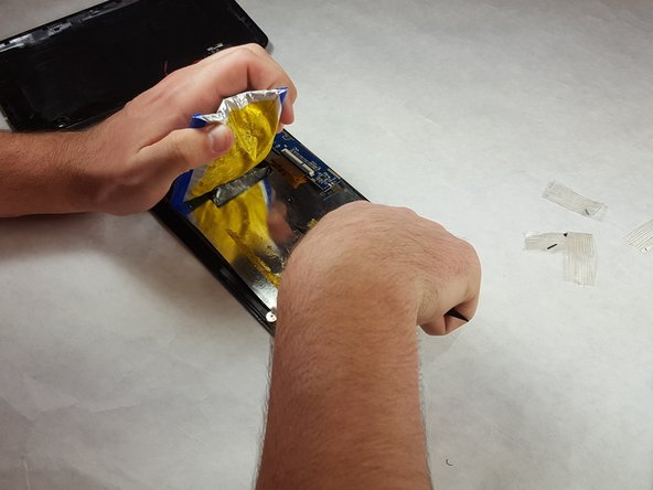 Carefully peel the battery free from the casing.