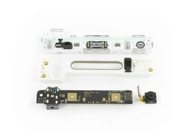Image 2/2: We start with the top module: the front-facing camera pops right off thanks to a simple flex cable connector.