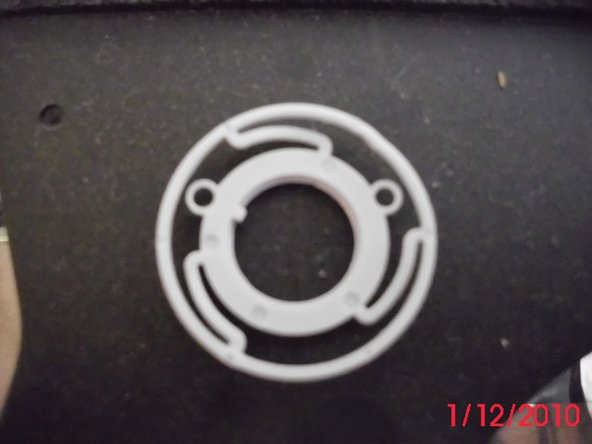 Here it is with the back plate of the button pried off.  This exposes a white plastic washer under it.