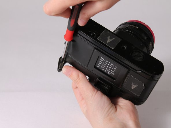 Place the plastic cover onto the advance lever and use a Philips screwdriver  to place it together.