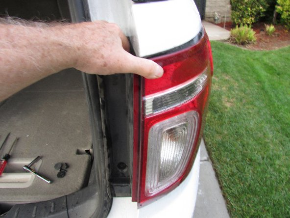 Gently pull the tail light cover from the car.