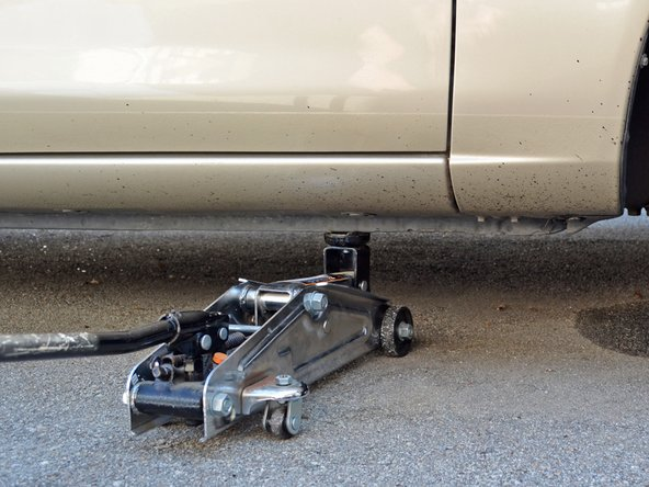 Image 1/3: Use the jack to raise the car enough to comfortably work under it.