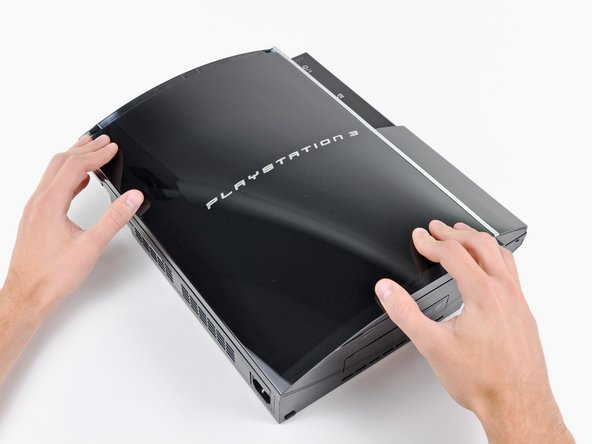Image 2/3: Pull the smart plate toward the hard drive bay, then lift it off the body of the PS3.