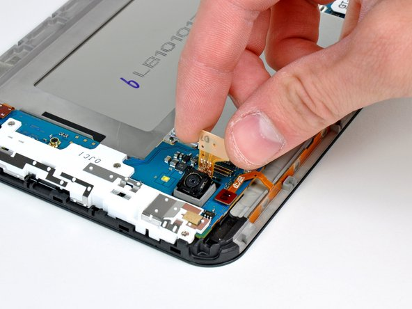 Lift and remove the rear camera from the Galaxy Tab.
