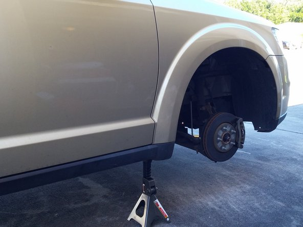 Use the hydraulic jack to lift the vehicle, place the jack stand, and lower the car so that it rests on the jack stand.
