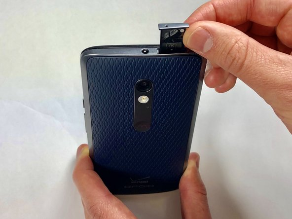 Pull the sim card tray up out of the phone