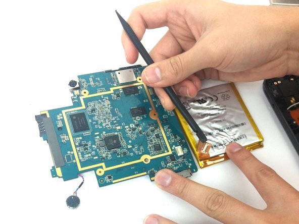 Use the spudger to lift up and detach the cable connecting the battery to the motherboard.