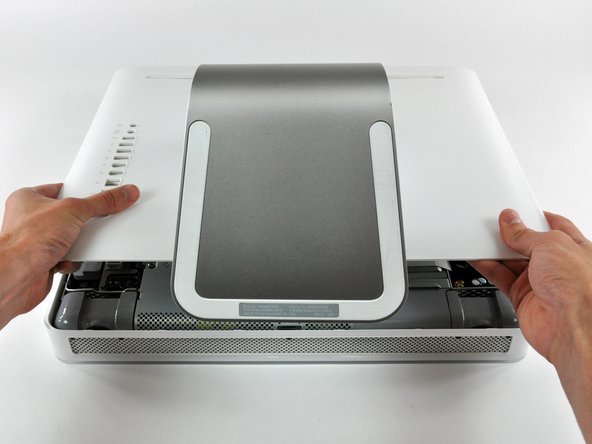 Image 3/3: Pull the rear panel toward yourself and remove it from the iMac.