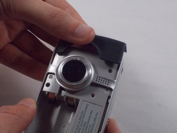Slide the black upper casing off from the device.