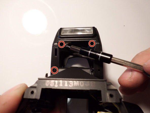 Image 1/2: Remove the flash cap