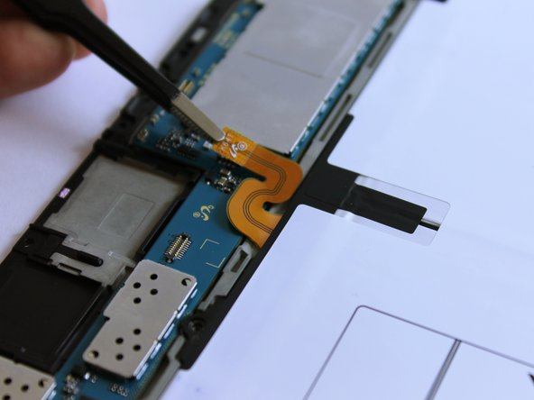 Image 2/3: Remove the four black 3mm screws using a PH000 Phillips screwdriver.