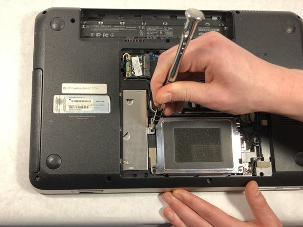 Using a Phillips #0 screw driver, remove the single 4mm screw holding the optical drive in place