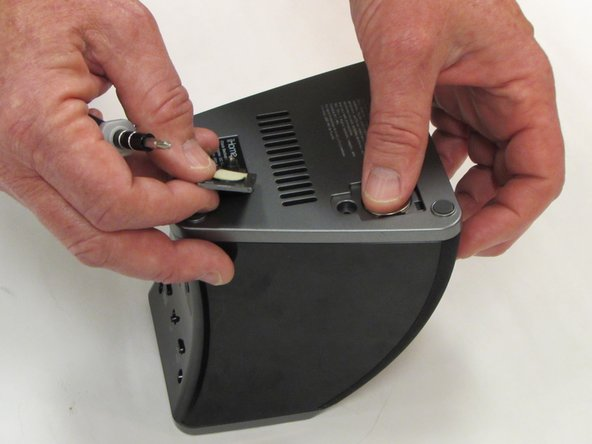 Lift battery with fingers or using spudger