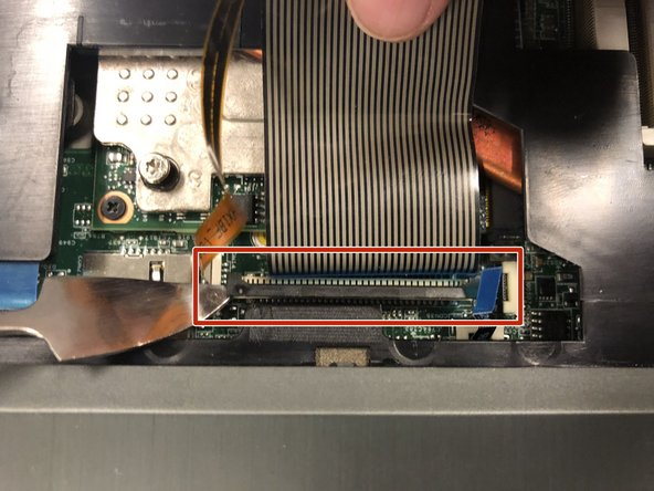 Locate the black rectangle base at the bottom of the thick ribbon cable.