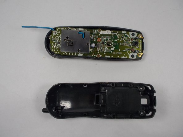 Refer to the Uniden EXP 371 phone disassembly guide to open the plastic casing.