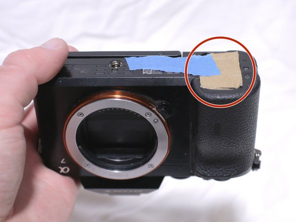 Flip the camera upside down, and observe where the battery door and switch are located on the camera.