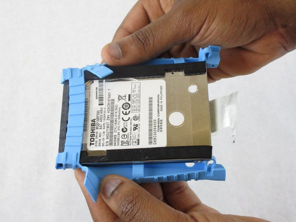 Remove the hard drive from the blue rubber mount.