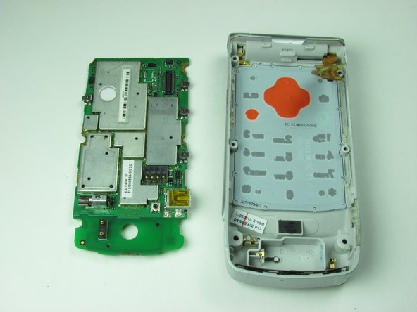Gently remove the logic board from the phone casing.