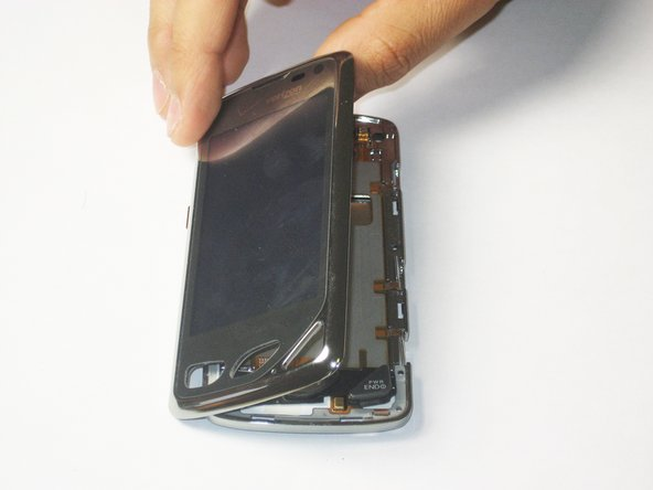 Use a plastic opener tool to get in between the front screen and main body of the phone and loosen it around the edges.