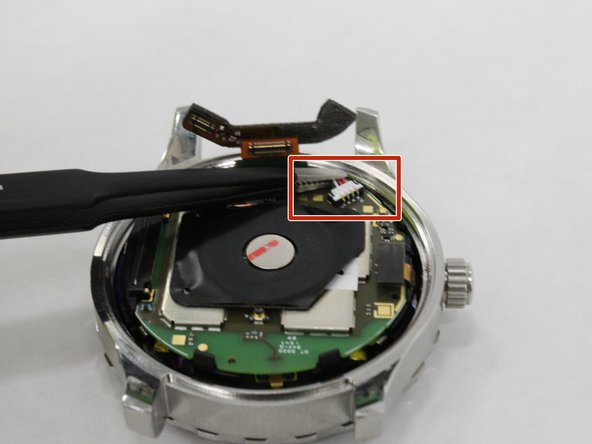 Utilize tweezers to pull the white battery connector from the motherboard.