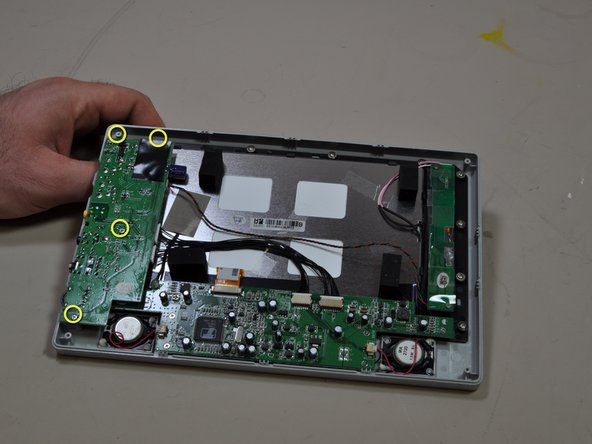 Use a Philips #0 screwdriver to remove the five screws on the board.