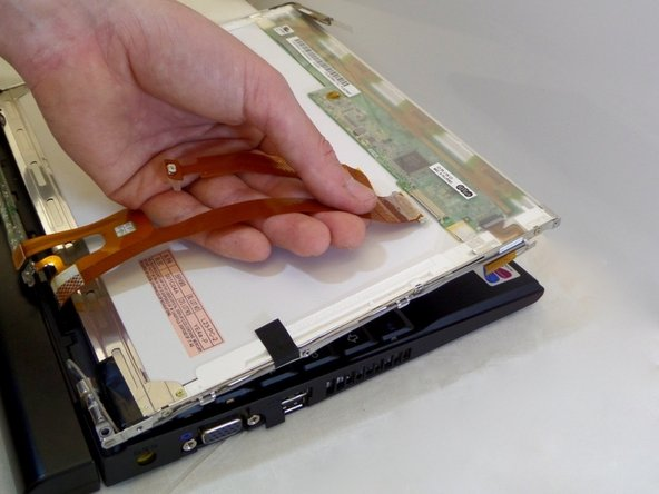 Carefully disconnect the orange cable from back of LCD screen.