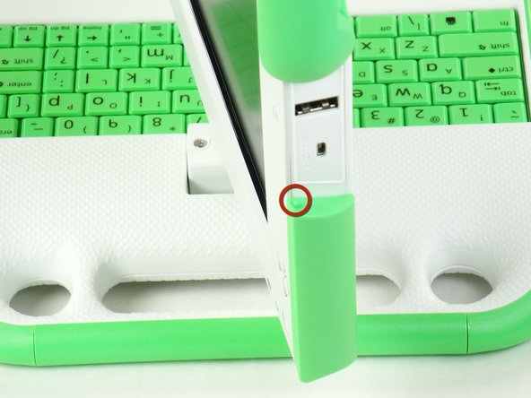 Remove the green side panel by pressing down on the small green button on the top and sliding the panel up.