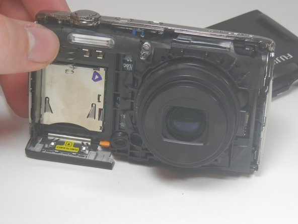 Be careful that the sensor cover—the small piece of translucent plastic—doesn't fall out of place. Return it to its original location if it does.