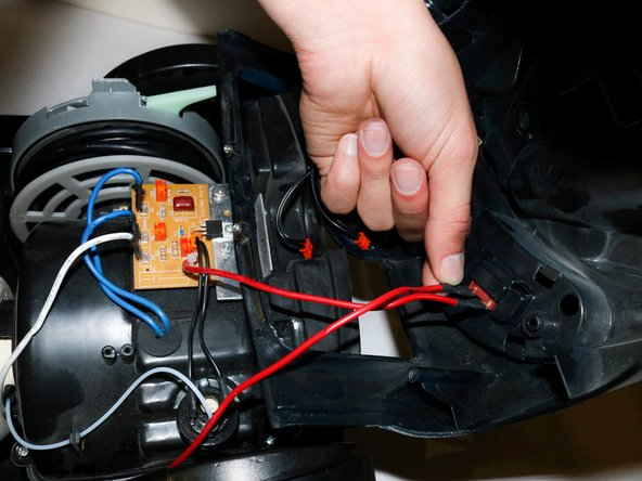 Unplug the red wires. The wires may be a little difficult to take off. If they are, you may use a pair of pliers to pull the wires off.