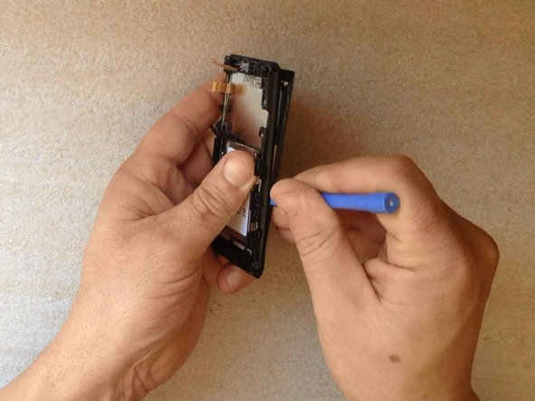 By using plastic tools gently start separating.