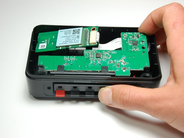 Using both thumbs, push the front speaker input terminal back towards the inside part of the device.