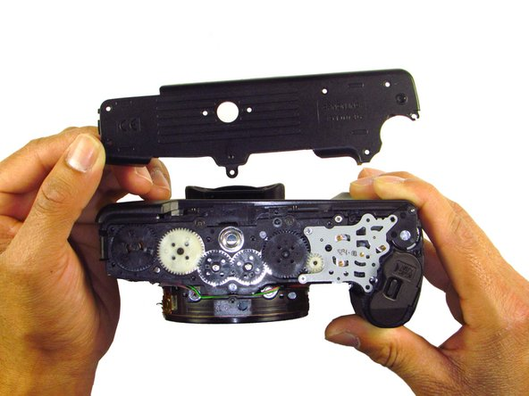 When removing the panel, be sure the bottom of the camera is facing upright.  There are loose gears that may fall out.