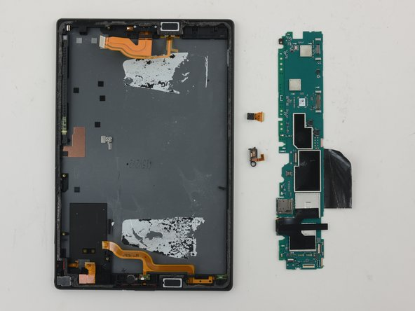 Image 1/2: Modular motherboard components include camera and microphone.