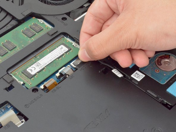 Gently lift the HDD cable to disconnect it from the laptop.