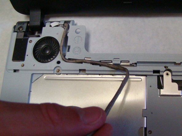 Place the power and display cables for the new screen into their respective grooves.