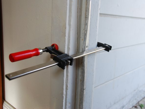 Use a clamp with rubber edges for a sturdier grip and also to prevent damaging the door frame.