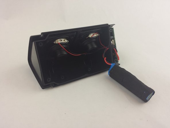 Image 3/3: Remove the battery from the inside compartment for replacement.