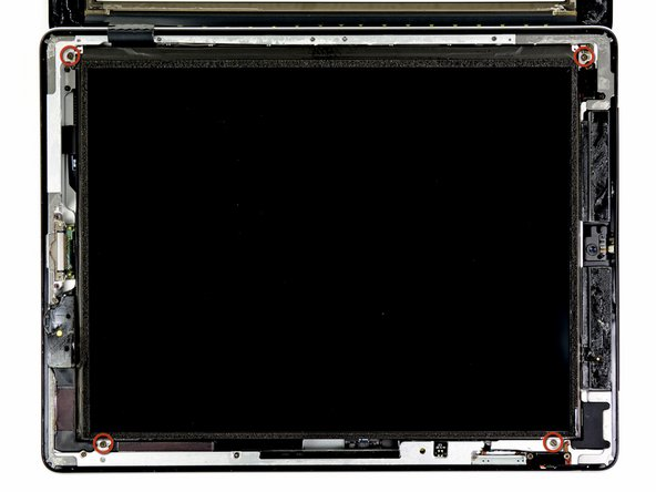 Image 1/1: Remove the four 2.0 mm Phillips screws securing the LCD to the rear case.