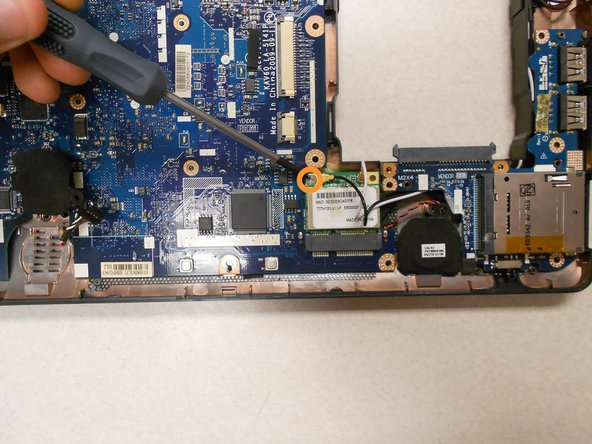 Remove the one (1) 5mm screw holding the card to the motherboard using a Phillips #0 screwdriver.