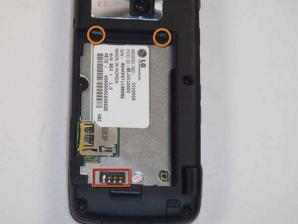 Image 1/1: Insert the top of the battery, with the two plastic tabs, into their respective holes in the top