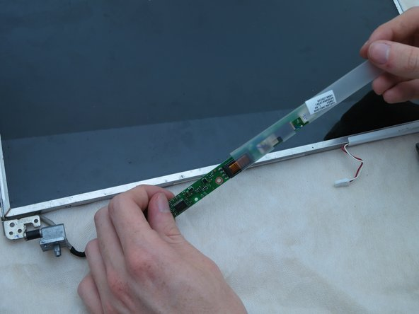 Image 2/3: In order to access the second connector, you will need to remove the protective plastic cover. Make sure to put this back on when installing the next screen.