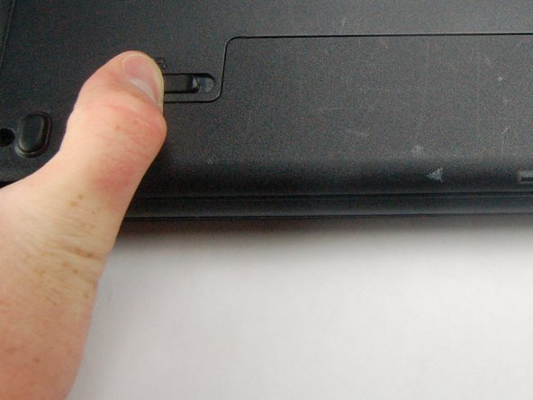 Slide latches on both sides of battery outwards.