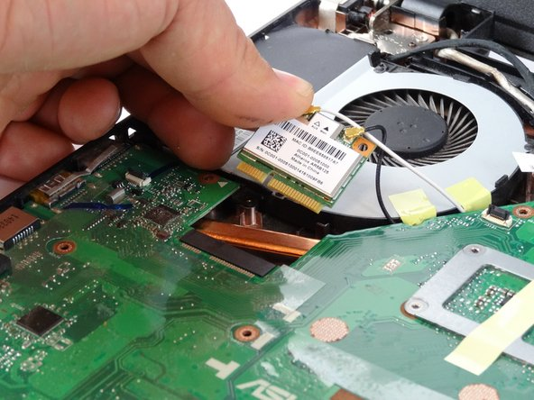 Pull out WiFi from below the cooling fan by lifting the edge nearest to the fan and sliding it towards the fan.