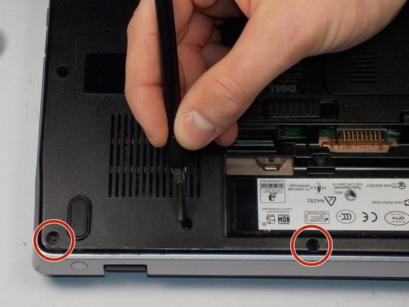 Remove seven 8.6mm screws from the left and right side of the battery compartment