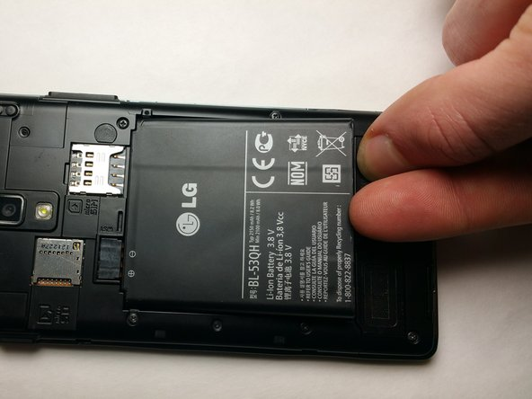Lift and remove the battery from the notch in the edge of the battery compartment