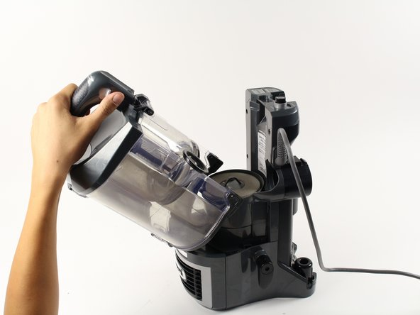 Lift the dust cup away from from the body of the vacuum to uncover the foam filter.