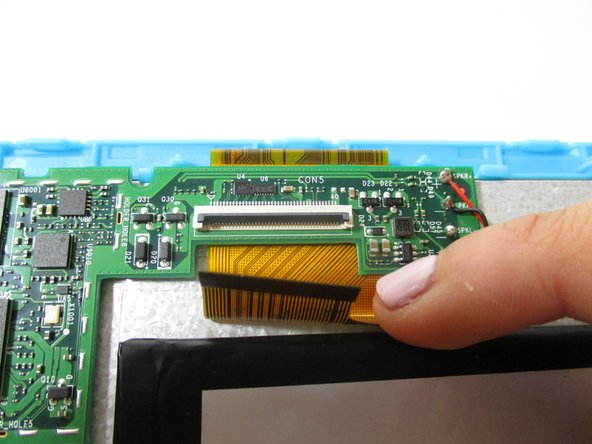 Remove the orange data display ribbon wire above the battery by prying open the ZIF connector with the plastic opening tool.