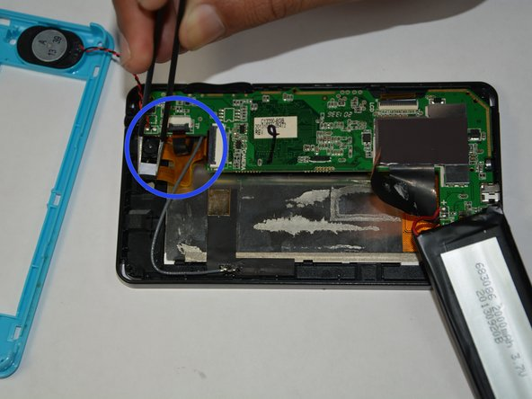 Detach the camera module and other components that are attached to the motherboard.